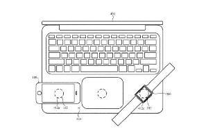 苹果新专利曝光:有望在 MacBook 上为 iPhone 无线充电