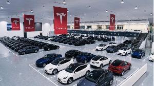 特斯拉获赫兹10万辆汽车订购大单,市值超一万亿
